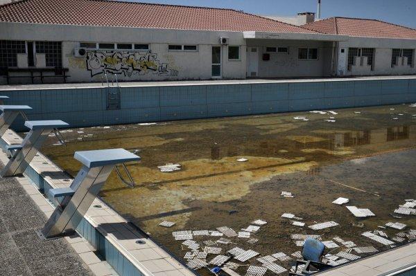 – L'une des piscine d'entraînement des JO 2004 (Crédits – Getty Images / Milos Bicanski)